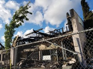 """Gentrification brings late night fires, a quick way to clear out the """"undesirables"""" so as to upscale the hood for the """"beautiful people."""" – Photo: Tiny, Poor News Network"""
