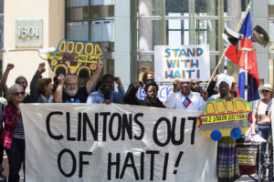 "Several members of the picket line chanted ""Clintons out of Haiti,"" one of two very important international messages addressed at the ""Day of Action for Haiti."" – Photo: Malaika H Kambon"