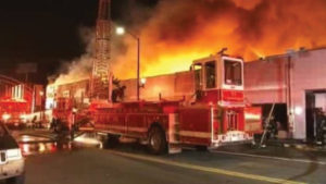 Ten families, the owners and operators of 10 small businesses on MacArthur – BlackArthur in Deep East Oakland – lost everything in a mysterious fire in the wee hours of the morning on May 21. This photo was taken at 4 a.m.