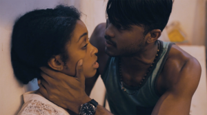 "Gyerlini Clarke as Penny and Aaron Charles as George in a scene from ""Trafficked"""