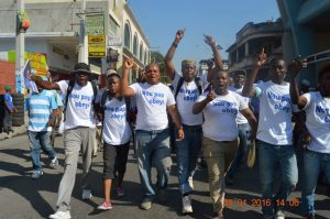 "These Haitian men are not afraid to say, ""We will not obey!"" – Photo: Haiti Information Project"