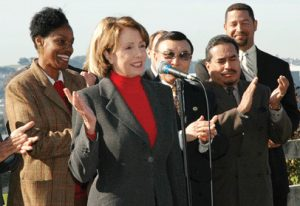 "Congresswoman Nancy Pelosi gleefully announces the ""dirty transfer"" of Parcel A of the Hunters Point Shipyard from the Navy to the City and mega-developer Lennar in January 2005. Top Navy officials opposed the transfer because Parcel A had not yet been cleaned to residential standards. Pelosi tried to squelch reports of extraordinarily high breast cancer rates among young Black women in Hunters Point for fear any link to the shipyard, one of the most polluted places in the U.S., would kill the deal. She claimed there was no evidence of a connection between pollution and breast cancer, but Dr. Ray Tompkins' students found just such a study, and many more have followed since. The Pelosi family is heavily invested in Lennar."