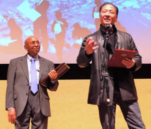 At the Bay View's 40th anniversary celebration at the San Francisco Main Library on Feb. 21, 2016, San Francisco's elected – and beloved – Public Defender Jeff Adachi gave the paper an award. Bay View publisher Dr. Willie Ratcliff stands behind him. Jeff, respected as one of the best, if not THE best public defender in the country, is also a visionary – and now a filmmaker! – Photo: Harrison Chastang