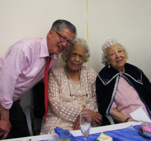 Anh Le joins Ms. Pickens (right) and her sister, Ms. Vera Miyasaki, for a photo at the Senior Center celebration on June 11. – Photo: Anh Le