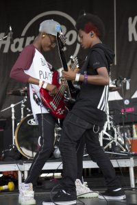 "Alec Atkins on bass and Malcolm Brickhouse on lead guitar of Unlocking the Truth band perform on tour in the new film, ""Breaking a Monster."" – Photo courtesy Emerald Gold"