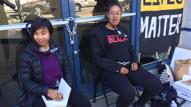 "BLM protesters shut down the Police Officers Association headquarters in Oakland for 13 hours. On the Black Lives Matter Bay Area Facebook page is this note: ""After a 13-hour shutdown of the police union office, the police supply store and the police credit union, we wanted to leave something special. We left our locks and chains ... around the doors."" – Photo: KGO-TV"