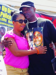 Uncle Bobby comforts Marcia Yearwood, mother of police victim Nate Wilks, at a Black Lives Matter rally at the 24th and Mission BART Plaza on Aug. 23, 2015. – Photo: Harrison Chastang