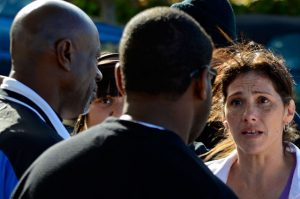 Uncle Bobby comforts and counsels Rachel Guido Red, mother of Derrick Gaines, only 15 when he was murdered by South San Francisco police, at Derrick's memorial on June 12, 2012. That killer cop, Joshua Cabillo, has since been hired by the San Francisco Police Department and is already the subject of several complaints of brutality here. – Photo: Alex Darocy