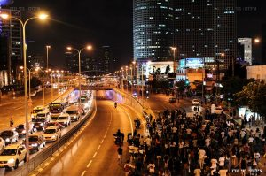 Ethiopian-Israeli protestors block a main traffic artery in Tel Aviv in front of the iconic Azrieli Center. – Photo: Benny Woodoo