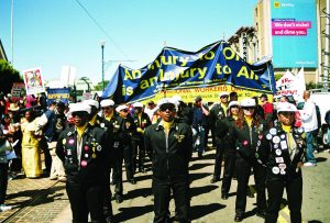 The ILWU Drill Team leads the big May Day March on May 1, 2008. – Photo: Lee Hubbard