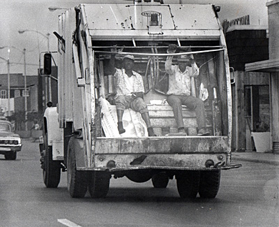 "In Memphis, sanitation workers were forced to ride in the back of the garbage truck with the garbage. When two men were crushed to death on Feb. 1, 1968, they went on strike, carrying picket signs that said, ""I am a man,"" meaning, ""I am not a piece of garbage."""
