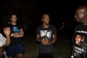 When Michael Brown was murdered in Ferguson, Uncle Bobby responded immediately by going there, comforting and empowering the family and listening to the pain and anger expressed by others in the community. Here he is talking with protesters on the night of Aug. 27, 2014. – Photo: Brett Myers, Youth Radio