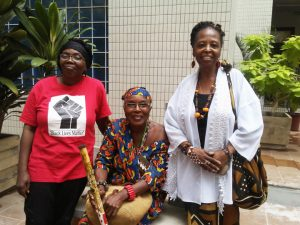 Sporting a Black Lives Matter t-shirt, One Africa joins Seestah Imahkas and Adjoa Childs in the courtyard of Superior Court in Accra, Ghana. – Photo: Wanda Sabir