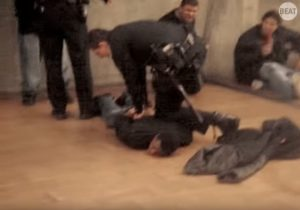 Oscar Grant face down Fruitvale Stn platform BART police 010109-2 vid by Tommy Cross via LA Superior Ct, web