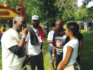 In Ferguson, Uncle Bobby talks with Ron Davis, father of Jordan Davis, and Tracy Martin, father of Trayvon Martin, on Aug. 27, 2014. – Photo: Kumasi Aaron