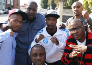 "On a ""Stay Black and Die"" video shoot are JR Valrey, Ray Luv, M1 of dead prez, Mac Mall and DLabrie."