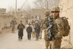 "This U.S. Army National Guard soldier patrolling a village in the Bagram Security Zone of Afghanistan in 2011 doesn't appear to want to win ""enemy"" hearts and minds. – Photo: U.S. Army"