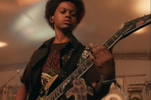 """Unlocking the Truth lead singer and guitarist Malcolm Brickhouse in """"Breaking a Monster"""""""