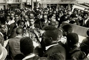"""The community turned out in force for the funeral of Matthew """"Peanut"""" Johnson, 16, whose murder by SFPD on Sept. 27, 1966, 50 years ago, caused an explosion of protest known as the Hunters Point Uprising, the second major """"riot"""" in the U.S. of the turbulent '60s. Note that, unlike in many other cities, protesters did not destroy their own, then mostly Black-owned neighborhood. – Photo courtesy SF Public Library History Center"""