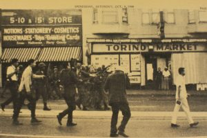 """Protesters, laying claim to Third Street, """"main street"""" in Bayview Hunters Point, bravely walk past National Guard troops, described at the time as young, white and terrified, the kind of fear that can make an officer trigger-happy. – Photo: The Hunters Point Bayview Spokesman"""