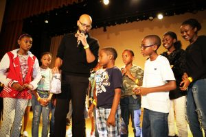 Theo Miller of the San Francisco Mayor's Office speaks to SFUSD students during a raffle at the 2015 Black Family Day.