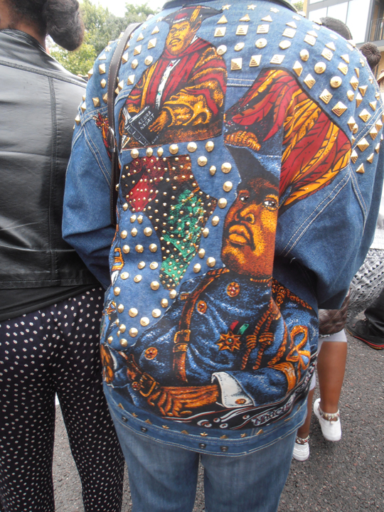 God(dess) Makeda Coaston, formerly of San Francisco and now living in London, wears Marcus Garvey on her back. Ase'.