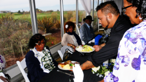 At her Milestone Birthday Celebration earlier this summer at Metropolitan Golf Links in Oakland, Mary Wilson is served by the chef.