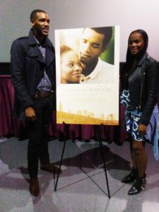 Tika and Parker pose with the poster for the film. – Photo: Wanda Sabir