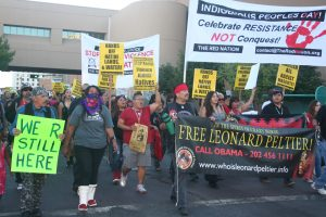 On Oct. 12, 2015, Albuquerque's first Indigenous People's Day, formerly known as Columbus Day, hundreds march to free Leonard Peltier. – Photo; Steve Ranieri