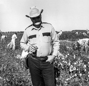 Prison-slavery-field-lieutenant-with-prisoners-picking-cotton-Cummins-Prison-Farm-Texas-1975-cy-Marshall-Project-cropped-300x288, George Jackson University supports the historic Sept. 9 strike against prison slavery, Behind Enemy Lines