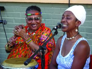 Each evening, at the King and Queen Emporium, home of Zion Trinity, the doors were open to Black Arts Movement conference attendees to come and dance, dine and dialogue with New Orleans folk. Mama C performed with others that first night in front of the store. It was fun hanging out listening to live music and musicians freestyling, as Andaiye is doing here. – Photo: Wanda Sabir