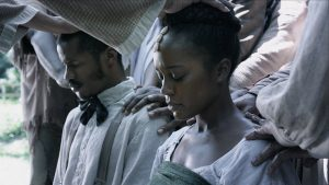 """Nate Parker as Nat Turner marries Aja Naomi King as Cherry in """"Birth of a Nation."""""""