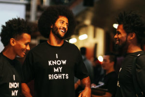 Colin Kaepernick shares a laugh with teenagers at his Know Your Rights camp in Oakland. – Photo: Katrina Britney Davis, The Undefeated