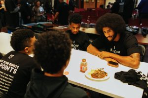 San Francisco 49ers quarterback Colin Kaepernick talks with some of the children over lunch at the HUB Oakland on Oct. 29, 2016. – Photo: Katrina Britney Davis, The Undefeated