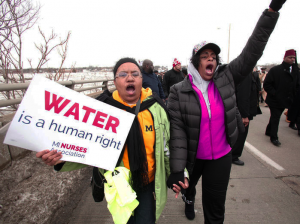 People participate in a national mile-long march in February to highlight the push for clean water in Flint, Mich. – Photo: Bill Pugliano