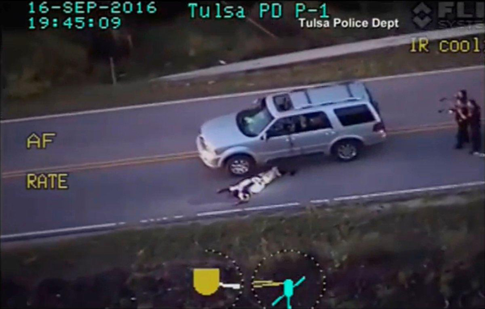 This image from a helicopter shows Tulsa PD murdering unarmed stranded motorist Terence Crutcher, who has his hands in the air.