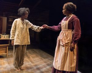 """Roxie (actress Jamella Cross), left, is an escaped slave looking for sanctuary and freed woman Clarissa (Dezi Soléy) in the play, """"Safe House."""""""
