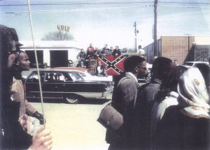 Selma-march-KKK-Confederate-flag-032165-by-Doug-Knott-cy-Jack-Hirschman-web-300x215, When we don't fight hate, we are preparing for others to die, Behind Enemy Lines