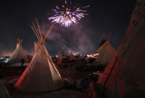 Standing-Rock-fireworks-Oceti-Sakowin-Camp-celebrates-DAPL-permit-denial-120416-by-Scott-Olson-web-300x202, Temporary victory at Standing Rock, National News & Views