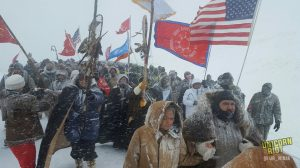 Standing-Rock-hundreds-of-water-protectors-vets-march-to-Backwater-Bridge-in-blizzard-120516-by-Unicorn-Riot-300x168, Temporary victory at Standing Rock, National News & Views
