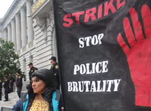 Strike-Stop-Police-Brutality-protest-on-SF-City-Hall-steps-deputies-watching-2016-by-Sana-Saleem-300x220, Acquittal, hung jury for Michael Smith, beaten by BART cops on video, Local News & Views