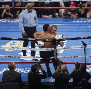 Kovalev's inability to outbox Andre Ward showed in his use of illegal headlocks, wrestling tactics and tying up Ward's arms by holding the ropes. – Photo: Malaika Kambon