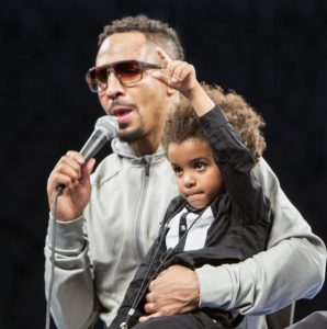 "A victorious Andre Ward holds his son Micah, aka ""Champ,"" who shows the world his dad is number 1! – Photo: Malaika Kambon"