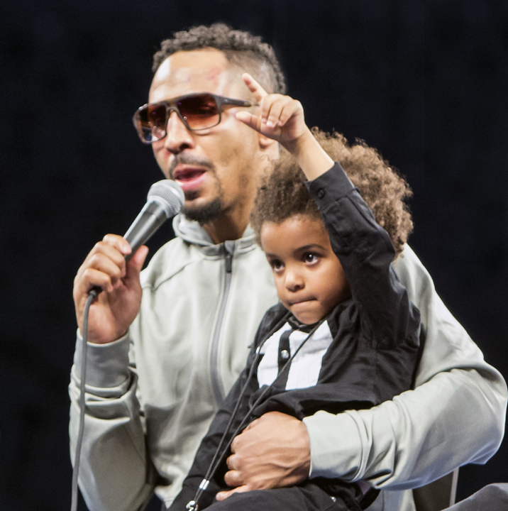 """A victorious Andre Ward holds his son Micah, aka """"Champ,"""" who shows the world his dad is number 1! – Photo: Malaika Kambon"""