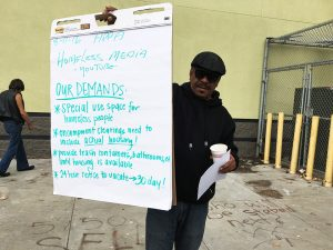 Bilal-Ali-holds-demands-list-from-Popular-Assembly-081616-by-COH-300x225, Citywide homeless people's assembly Tuesday to honor Martin Luther King, Local News & Views