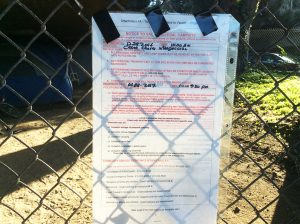 Cesar-Chavez-Freeway-exit-encampment-eviction-notice-123116-by-Dr.-Betty-McGee-web-300x224, In search of human rights: Is homelessness a crime punishable by lockouts?, Local News & Views