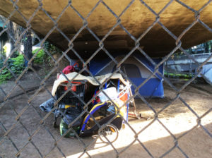 Cesar-Chavez-Freeway-exit-encampment-tent-123116-by-Dr.-Betty-McGee-web-300x224, In search of human rights: Is homelessness a crime punishable by lockouts?, Local News & Views