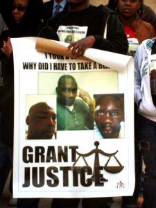 Georgia-prison-striker-advocate-holds-poster-beaten-prisoners-at-press-conf-010611-by-Kristi-Swartz-AJC.com_-225x300, Tier II is straight torture, Behind Enemy Lines