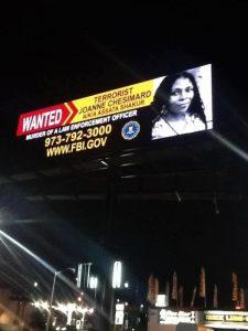New-Jersey-billboard-erected-night-before-FBI-announcement-Assata-Shakur-050213-225x300, FBI, the political police, National News & Views