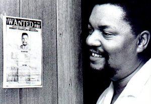 Robert-Williams-examines-his-FBI-Wanted-poster-Havana-1963-by-Robert-Carl-Cohen-300x206, FBI, the political police, National News & Views